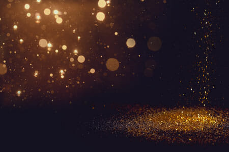 Dark background with golden sparkles